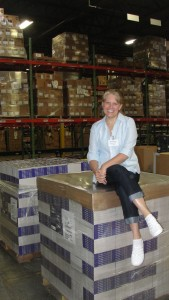 My visit to the Harlequin Distribution Center in New York. I'm sitting on a pallet of books of WARNING SIGNS.