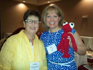 Debbie Macomber taught me how to knit on a writer's cruise in 2004. When I saw her again in Milwaukee at the Barbara Vey Reader's Luncheon in 2014. I was thrilled to show her my knitting skills after ten years.